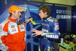 Valentino Rossi chats with Stéphane Peterhansel