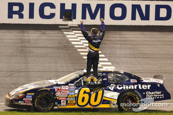 Race winner Carl Edwards salutes his fans