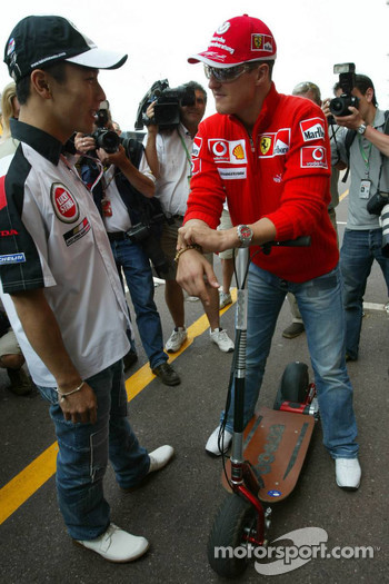 Takuma Sato and Michael Schumacher