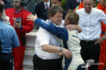 Nick Heidfeld congratulated by Norbert Haug