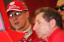 Michael Schumacher looks at the results of the race
