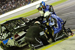 Ryan Newman's team works to fix the damage
