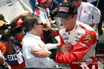 Pole winner Sébastien Bourdais celebrates with Carl Haas