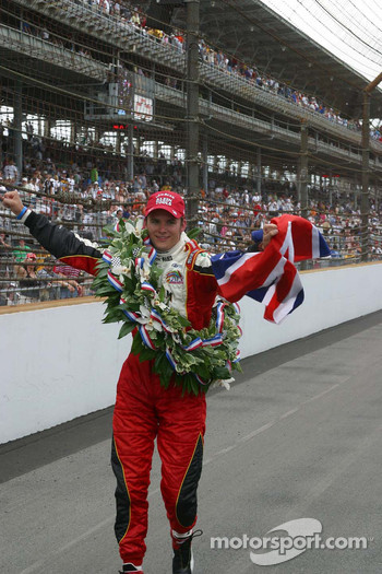Dan Wheldon celebrates his victory in the Indianapolis 500