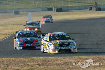 Craig Lowndes beat Marcos Ambrose out after their pit stop