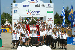 Podium: winners Sébastien Loeb and Daniel Elena celebrate with Citroën Sport team members