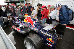 Fans have a look at the Red Bull car