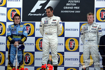 Podium: race winner Juan Pablo Montoya with Fernando Alonso and Kimi Raikkonen