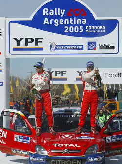 Podium: race winners Sébastien Loeb and Daniel Elena celebrate