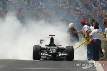 The Minardi of Robert Doornbos on fire