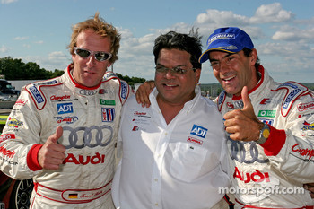 Race winners Frank Biela and Emanuele Pirro celebrate with Dave Maraj