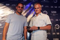 Juan Pablo Montoya presents the award for Driver of the Year to Heikki Kovalainen