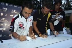 Takuma Sato, Tiago Montiero and Enrico Toccacelo autograph their hand prints