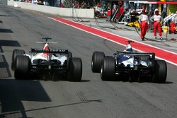 Takuma Sato and Mark Webber battle at pit exit