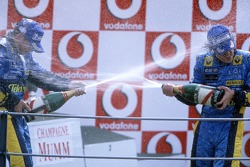 Podium: champagne for Fernando Alonso and Giancarlo Fisichella