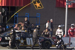 A team Army member falls during a pitstop
