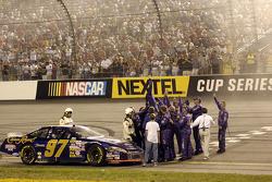 Race winner Kurt Busch celebrates with his crew