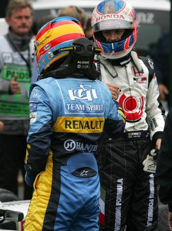 Fernando Alonso and Jenson Button congratulate each other