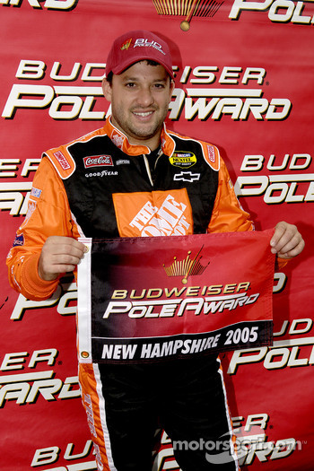 Pole winner Tony Stewart celebrates