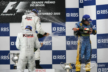 Podium: champagne for Juan Pablo Montoya, Kimi Raikkonen and Fernando Alonso