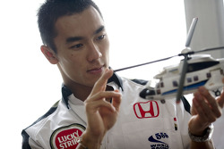 At home in Tokyo with Takuma Sato: Takuma Sato about to climb aboard an helicopter