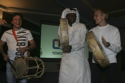 Heikki Kovalainen and Giorgio Pantano join in the local drummers