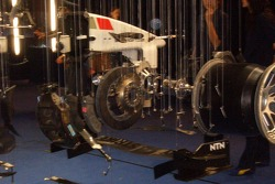 A BAR Honda display with a dismantled F1 car hanging from the roof on fishing lines
