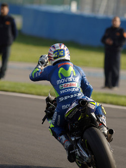 Race winner Marco Melandri celebrates