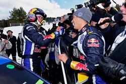 Third place Andreas Mikkelsen and rally winner Sebastien Ogier celebrate