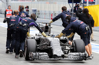 The Red Bull Racing RB11 of Daniel Ricciardo, Red Bull Racing RB11 is pushed down the pit lane by mechanics