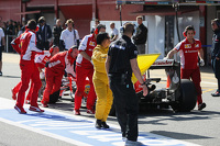The Ferrari SF15-T of Sebastian Vettel, Ferrari is pushed down the pit lane