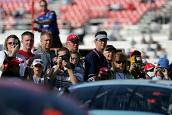 Fans watch the cars as they head to track