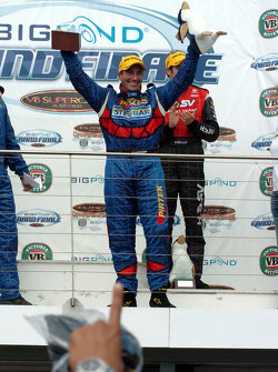 Podium: race winner Marcos Ambrose celebrates