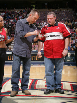 Jeremy Mayfield signs an autograph during the game between the New Jersey Nets and the Detroit Pistons at the Continental Airlines Arena in East Rutherford, New Jersey