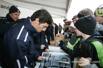 Mark Webber signs autographs