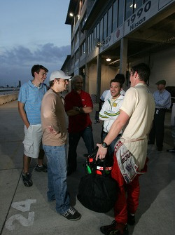 Team PTG and Panoz drivers discuss after the afternoon session