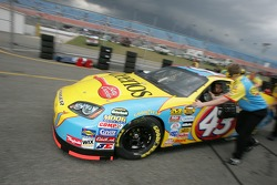 Bobby Labonte rushes to the track before rain starts falling