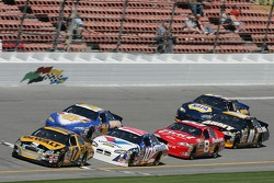 Matt Kenseth leads a group of cars