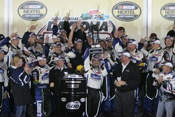 Victory lane: crew chief on duty Darian Grubb hoists trophy