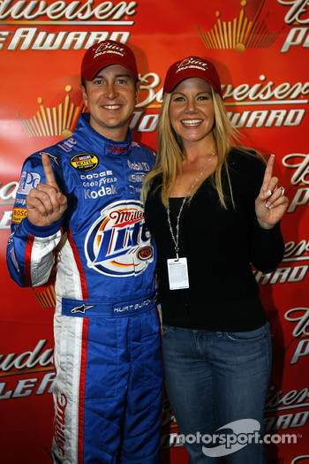 Pole winner Kurt Busch celebrates with fiancée Eva Bryan