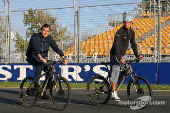 Vitantonio Liuzzi and race engineer Riccardo Adami ride around the track