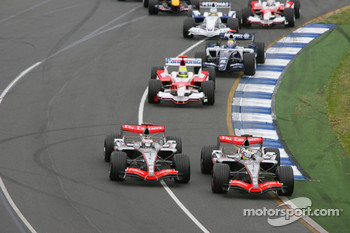 First corner: Juan Pablo Montoya and Kimi Raikkonen battle