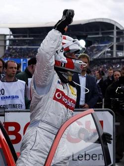 Bernd Schneider exits his car as a winner of the first 2006 DTM race