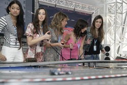 Chilled Thursday: the Formula Unas girls in the Red Bull Energy Station playing with the Carrera race cars