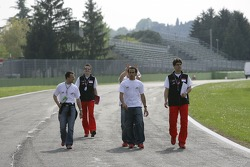 Alexandre Premat jokes with Lewis Hamilton on their track walk