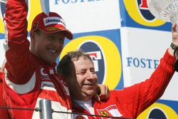 Podium: race winner Michael Schumacher celebrates with Jean Todt