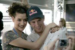 Scott Speed with a Formula Una girl in the Red Bull Energy Station