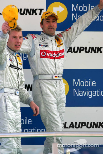 Podium: Race winner Bernd Schneider celebrates with Mika Hakkinen