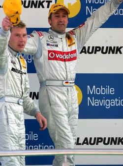 Podium: Race winner Bernd Schneider celebrates with Mika Hakkinen