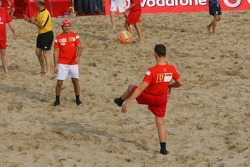 Vodafone Ferrari Beach Soccer Challenge: Michael Schumacher passes the ball to Felipe Massa